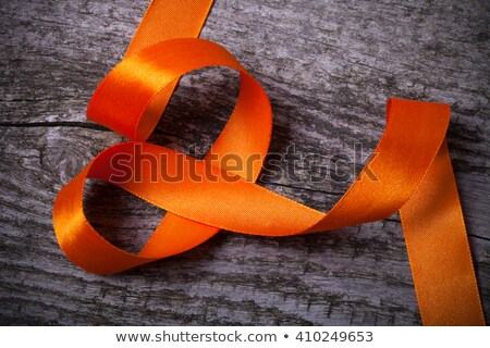 orange ribbon on a wooden surface Stock photo © nito