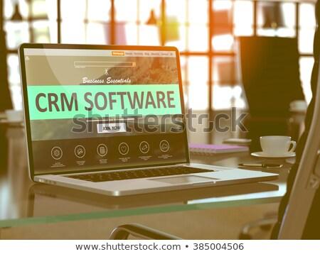 crm on laptop in modern workplace background stock photo © tashatuvango