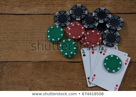 View carte maroon chip tavolo in legno legno Foto d'archivio © wavebreak_media