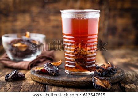 Prune drink, dried plums extract, fruits beverage Stock photo © yelenayemchuk