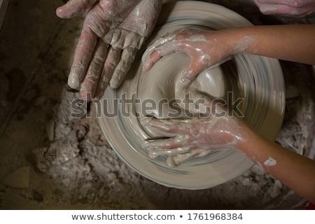 Male potter assisting his daughter in making a pot Stock photo © wavebreak_media