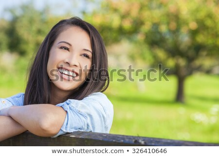 Young girl on gate in countryside Stock photo © IS2