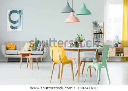 Woman on a ladder, in living room Stock photo © IS2