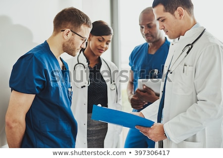 nurse and doctor in discussion stock photo © is2