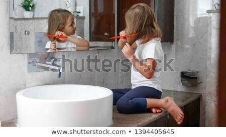little girl combing her hair Stock photo © IS2