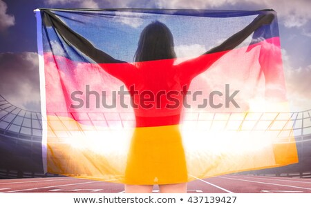Athlete posing with german flag after victory Stock photo © wavebreak_media