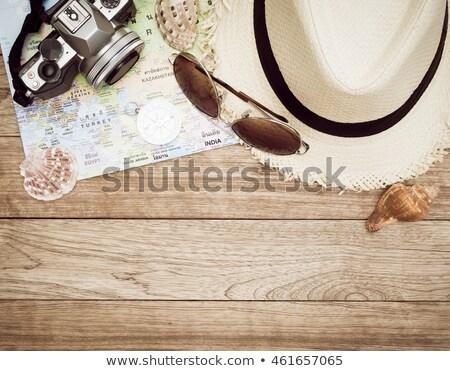 Travel accessories on wooden floor Stock photo © wavebreak_media