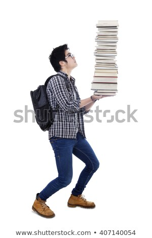 college student carrying a heavy pile of books stock photo © rastudio