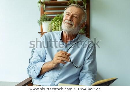érett férfi nő erkély férfi tenger kert Stock fotó © IS2