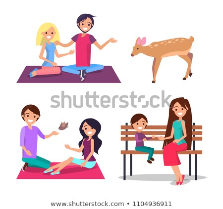 Stock photo: Man and Woman Sit on Blanket Feeding Deer Vector