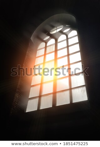 Sunlight glowing through arched windows. Stock photo © iofoto