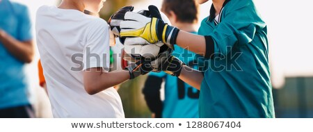 Kids Football Goalkeepers Improving Skills on Soccer Training. S Stock photo © matimix