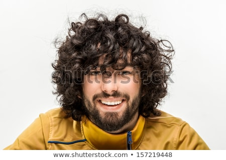 Portrait of a cheerful young man with curly hair Stock photo © deandrobot