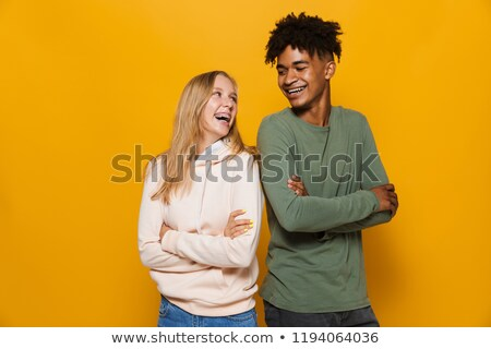 Photo of multiethnic couple man and woman 16-18 with dental brac Stock photo © deandrobot