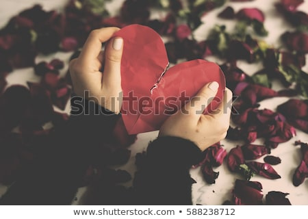 Stock photo: Couple's Hand With Divorce Paper And Broken Heart