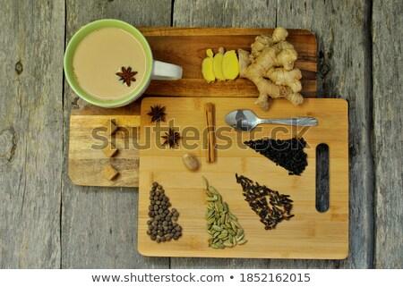 Brown cane sugar in wooden spoon on black board. Stock photo © marylooo