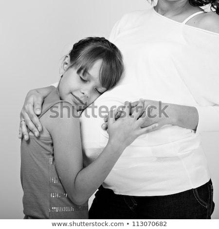 Bambina incinta madre studio famiglia ragazza Foto d'archivio © Lopolo