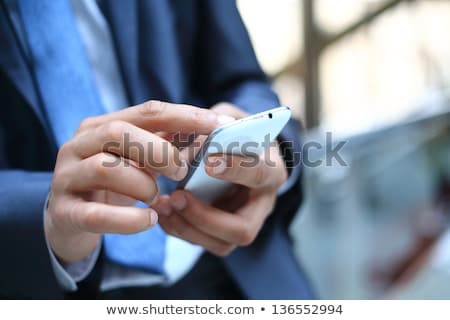 Close-up of business executive on cell-phone. Stock photo © lichtmeister