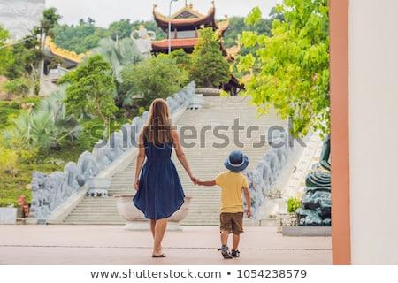 Happy tourists mom and son in LongSon Pagoda Stock photo © galitskaya