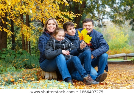 Father with children in the autumn birch forest. Stock photo © Lopolo