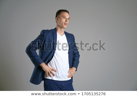 Portrait of a young handsome male, correcting a tie Stock photo © Elmiko
