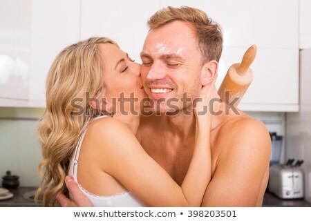 Mulher beijando marido bochecha homem beijo Foto stock © photography33