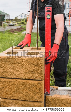 a mason using a level to check his wall stock photo © photography33