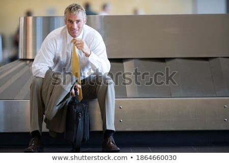 man posing in front of a carousel Stock photo © photography33