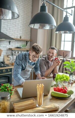 Couple looking-up recipe on laptop Stock photo © photography33