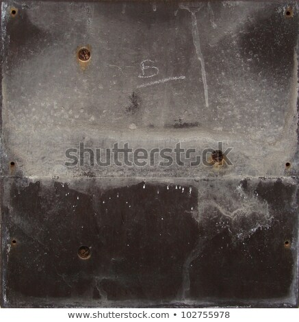 grunge gray black metal plate with screws and leak Stock photo © Melvin07