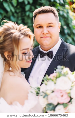 Bride and groom in solemn moment Stock photo © pzaxe