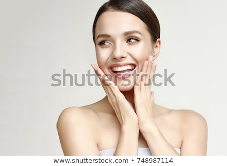 Smiling Woman Holding Hands Up in Surprise Stock photo © scheriton