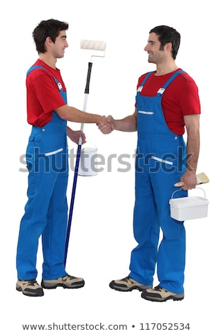 Stock photo: duo of painters shaking hands