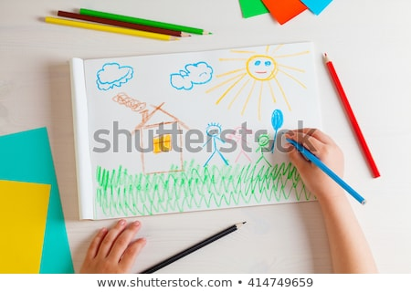 Woman and child colouring at a desk Stock photo © photography33