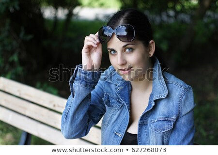 Smiling woman taking her sunglasses off Stock photo © photography33