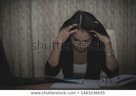 businesswoman removing document from case stock photo © photography33