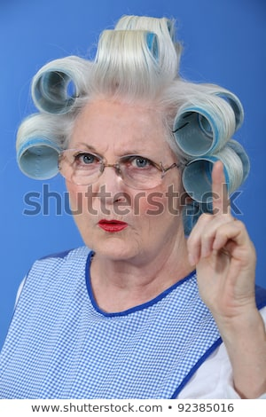 Stock photo: Old woman waving her finger in disapproval