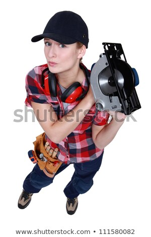 female carpenter wielding circular saw stock photo © photography33
