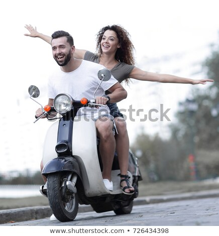 couple driving scooter in love stock photo © maridav