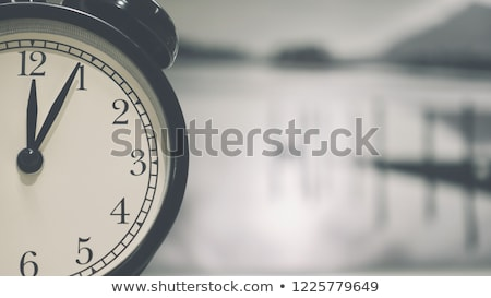 close up of black bell clock (alarm clock) isolated on white bac Stock photo © tetkoren