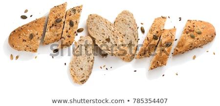 Kenyér szeletek búza fülek magvak fa asztal Stock fotó © stevanovicigor