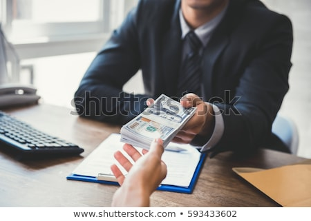 man making a cash payment stock photo © andreypopov