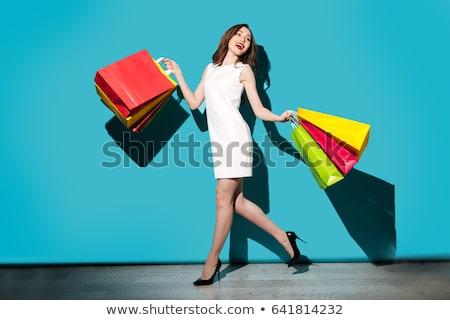 határozatlan · nő · bevásárlótáskák · aranyos · lány · visel - stock fotó © hasloo