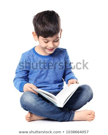 alegre · pequeño · nino · nino · lectura · libro - foto stock © hyrons