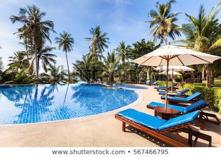 sunloungers on swimming pool  Stock photo © artush
