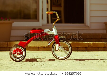 Child's rusted red tricycle standing ready stock photo © ozgur