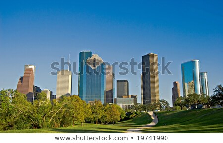 High-rise building under blue sky with road Stock photo © cherezoff