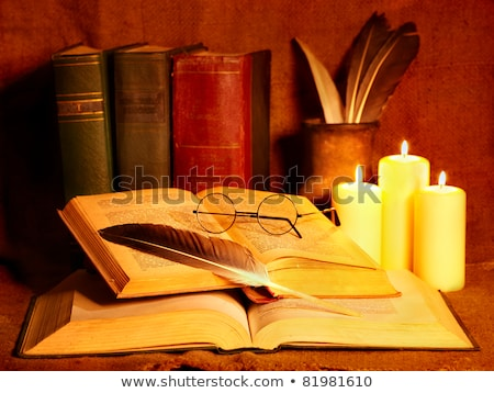 Books, glasses and candle on the night table. Stock photo © nenetus