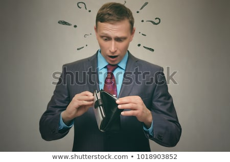 Stock photo: Business man looking shocked on little man