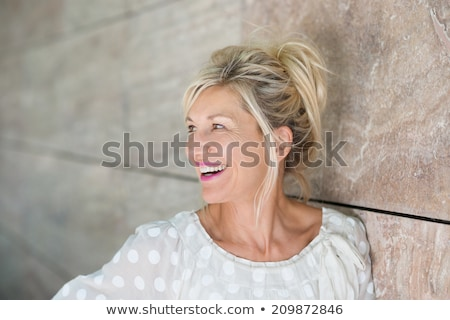 Pretty Woman Looking Out to the Left Against White Stock photo © ozgur